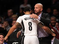 Mar 31, 2015; Brooklyn, NY, USA; Brooklyn Nets guard Deron Williams (8) drives to the basket defended by Indiana Pacers guard George Hill (3) during the first half at Barclays Center.