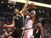 The hot-shooting Toronto Raptors topped the Cleveland Cavaliers, 103-99, at Air Canada Center in Toronto Wednesday.