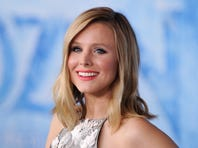 """HOLLYWOOD, CA - NOVEMBER 19:  Actress Kristen Bell arrives at the Los Angeles premiere of Disney's """"Frozen"""" at the El Capitan Theatre on November 19, 2013 in Hollywood, California.  (Photo by Allen Berezovsky/WireImage)"""