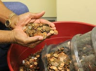 Otha Anders turned in a 45-year collection of pennies on Tuesday in 15 five-gallon water jugs.