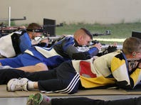 Air Force Academy cadet-turned-Marine 2nd Lt. David Higgins, center, is competing in men's prone rifle at the Rio 2016 Summer Olympic Games.