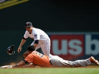 MINNEAPOLIS, MN - AUGUST 30: Carlos Gomez #30 of the Houston Astros advances to second base on a sacrifice from teammate Luis Valbuena #18 as Brian Dozier #2 of the Minnesota Twins looks to apply the tag during the second inning of the game on August 30, 2015 at Target Field in Minneapolis, Minnesota.