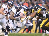 Dec 20, 2015; Pittsburgh, PA, USA; The Denver Broncos offensive line blocks against the Pittsburgh Steelers defense during the first quarter at Heinz Field.