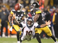 Dec 20, 2015; Pittsburgh, PA, USA; Pittsburgh Steelers cornerback William Gay (22) pass intended for Denver Broncos wide receiver Emmanuel Sanders (10) on Denver's final offensive play during the fourth quarter at Heinz Field. The Steelers won 34-27.