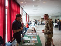 U.S. Army Lt. Col. Patrick Day, with Allied Command Transformation, talks about his post-military career with a recruiter during the Employment and Career Expo, at SHAPE, Belgium, June 17, 2016. (U.S. Army photo by Visual Information Specialist Pierre-Etienne Courtejoie/Released)