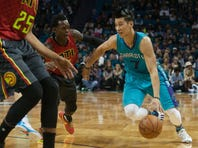 Charlotte Hornets guard Jeremy Lin (7) drives the ball during the first half against the Atlanta Hawks at Time Warner Cable Arena.