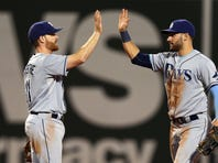 Tampa Bay Rays Logan Forsythe, left, and Kevin Kiermaier celebrate a victory against the Boston Red Sox at Fenway Park.