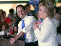 """SAN ANTONIO, TX - OCTOBER 15:  Secretary of Housing and Urban Development Secretary Julian Castro introduces Democratic presidential candidate Hillary Clinton at a """"Latinos for Hillary"""" grassroots event October 15, 2015 in San Antonio, Texas. The event was part of the campaign's ongoing effort to build an organization outside of the four early states and work hard for every vote.  (Photo by Erich Schlegel/Getty Images)"""