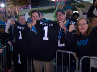 Fans welcome the Panthers home after a win over Dallas.