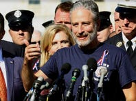 Comedian Jon Stewart stands with New York City first responders during a rally on Capitol Hill in Washington, Wednesday, September 16, 2015, calling for the extension of the the Zadroga Heath & Compensation Act that provides health care and compensation to 9/11 first responders and victims will come to an end if not renewed by Congress.