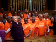 Hillary Clinton poses for a photo with members of the Brady Campaign to Prevent Gun Violence group after holding a Breaking Down Barriers Town Hall with Senator Cory Booker February 25, 2016.