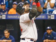 Boston Red Sox designated hitter David Ortiz (34) celebrates after he hits his 500th home run during the fifth inning of a baseball game against the Tampa Bay Rays at Tropicana Field.
