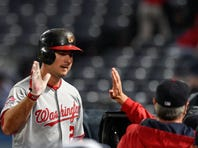 Oct 1, 2015; Atlanta, GA, USA; Washington Nationals first baseman Clint Robinson (25) reacts at the dugout after hitting a home run against the Atlanta Braves during the second inning at Turner Field. Mandatory Credit: Dale Zanine-USA TODAY Sports