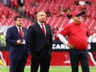 Sep 13, 2015; Glendale, AZ, USA; Arizona Cardinals head coach Bruce Arians (right) with general manager Steve Keim (center) and team president Michael Bidwill on the field prior to the game against the New Orleans Saints at University of Phoenix Stadium. The Cardinals defeated the Saints 31-19.