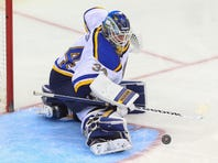 Nov 10, 2015; Newark, NJ, USA; St. Louis Blues goalie Jake Allen (34) makes a save during the third period at Prudential Center. The Blues defeated the Devils 2-0.  Mandatory Credit: Ed Mulholland-USA TODAY Sports
