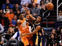 Dec 18, 2015; Phoenix, AZ, USA; Phoenix Suns guard Eric Bledsoe (2) passes the ball by New Orleans Pelicans guard Ish Smith (4) during the second half at Talking Stick Resort Arena. The Suns won 104-88. Mandatory Credit: Joe Camporeale-USA TODAY Sports