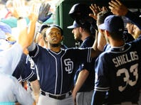 Aug 26, 2015; Washington, DC, USA; San Diego Padres left fielder Justin Upton (10) is congratulated by teammates after hitting a solo homer against the Washington Nationals during the seventh inning at Nationals Park. The San Diego Padres won 6-5. Mandatory Credit: Brad Mills-USA TODAY Sports