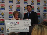 Julie Leach is presented with her $310.5M winning lottery ticket (Oct. 6, 2015)