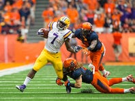 SYRACUSE, NY - SEPTEMBER 26:  Leonard Fournette #7 of the LSU Tigers breaks a tackled during the first half against the Syracuse Orange on September 26, 2015 at The Carrier Dome in Syracuse, New York.  (Photo by Brett Carlsen/Getty Images) *** Local Caption *** Leonard Fournette
