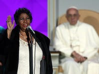 PHILADELPHIA, PA - SEPTEMBER 26: Pope Francis watches Aretha Franklin perform during the Festival of Families on September 26, 2015 in Philadelphia, Pennsylvania. Pope Francis is wrapping up his trip to the United States with two days in Philadelphia where he will attend the Festival of Families and will meet with prisoners at the Curran-Fromhold Correctional Facility. (Photo by Carl Court/Getty Images)