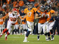 Quarterback Brock Osweiler #17 of the Denver Broncos delivers a seven yard touchdown pass to Andre Caldwell #12 of the Denver Broncos against the Kansas City Chiefs in the fourth quarter at Sports Authority Field at Mile High on November 15, 2015 in Denver, Colorado.