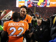 Quarterback Brock Osweiler celebrates with running back C.J. Anderson after defeating the New England Patriots 30-24 in overtime.