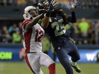 Nov 15, 2015; Seattle, WA, USA; Arizona Cardinals wide receiver John Brown (12) is defended by Seattle Seahawks cornerback Richard Sherman (25) during a NFL football game at CenturyLink Field. The Cardinals defeated the Seahawks 39-32.