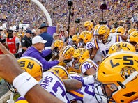 Oct 17, 2015; Baton Rouge, LA, USA; LSU Tigers head coach Les Miles leads the Tigers onto the field prior to kickoff against the Florida Gators at Tiger Stadium. The LSU Tigers defeated Florida 35-28. Mandatory Credit: Crystal LoGiudice-USA TODAY Sports