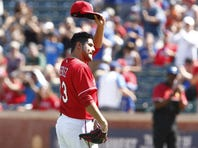 Texas Rangers starting pitcher Martin Perez (33) tips his cap to the crowd as he leaves the game in the ninth inning against the San Francisco Giants at Globe Life Park in Arlington. Texas won 2-1.