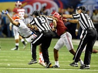 Dec 5, 2015; Atlanta, GA, USA; Florida Gators wide receiver Demarcus Robinson (11) and Alabama Crimson Tide defensive back Cyrus Jones (5) are separated by officials during the fourth quarter in the 2015 SEC Championship Game at the Georgia Dome. Alabama won 29-15. Mandatory Credit: John David Mercer-USA TODAY Sports