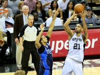 Spurs guard Manu Ginobili looks to pass in last year's season-opening victory against the Dallas Mavericks at the AT&T Center.