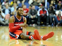 Dec 6, 2015; Washington, DC, USA; Washington Wizards guard John Wall (2) grimaces after suffering an apparent leg injury  during the second half at Verizon Center. Dallas Mavericks won 116 - 104. Mandatory Credit: Brad Mills-USA TODAY Sports