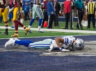 Dallas Cowboys wide receiver Terrance Williams (83) lies face down in the end zone