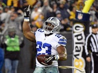 Dallas Cowboys running back Robert Turbin (23) reacts after scoring a touchdown in the third quarter during the game against the Green Bay Packers