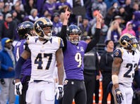 Nov 22, 2015; Baltimore, MD, USA; Baltimore Ravens kicker Justin Tucker (9) celebrates his game winning field goal against the St. Louis Rams at M&T Bank Stadium. Baltimore Ravens defeated St. Louis Rams 16-13. Mandatory Credit: Tommy Gilligan-USA TODAY Sports