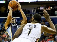Dec 1, 2015; New Orleans, LA, USA; Memphis Grizzlies guard Courtney Lee (5) shoots over New Orleans Pelicans guard Tyreke Evans (1) during the second quarter of a game at the Smoothie King Center. Mandatory Credit: Derick E. Hingle-USA TODAY Sports