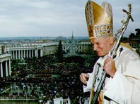 """Pope John Paul II stands on the balcony of St Peter's Church during his Christmas sermon in front of 30,000 people 25 december 1992. The Pope voiced his concern about """"hate and hostility"""" in the Holy Land and urged world leaders to seek solidarity to ensure peace."""