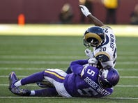 Nov 8, 2015; Minneapolis, MN, USA; St. Louis Rams cornerback Lamarcus Joyner (20) collides with Minnesota Vikings quarterback Teddy Bridgewater (5) for a personal foul in the fourth quarter at TCF Bank Stadium. Bridgewater did not return. The Vikings win 21-18.