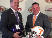 Butch Jones and Pat Fitzgerald speak before Outback Bowl