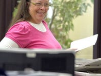 Rowan County Clerk Kim Davis smiles Aug. 18, 2015, as she helps a customer at the Rowan County Courthouse in Morehead, Ky.