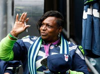 Nov 2, 2014; Seattle, WA, USA; Delisa Lynch waves as she signs autographs during pre game warmups against the Oakland Raiders at CenturyLink Field. Delisa Lynch is the mother of Seattle Seahawks running back Marshawn Lynch (not pictured).