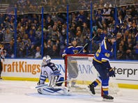 Nov 16, 2015; St. Louis, MO, USA;  St. Louis Blues center David Backes (42) celebrates after scoring a goal against Winnipeg Jets goalie Michael Hutchinson (34) during the second period at Scottrade Center. Mandatory Credit: Billy Hurst-USA TODAY Sports