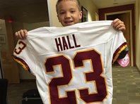 DeAngelo Hall gave his jersey to a young fan after he had to be carted off the field with a toe injury he suffered in Thursday night's loss to the Giants.