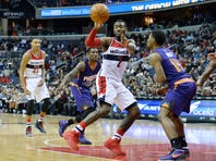 Dec 4, 2015; Washington, DC, USA;  Washington Wizards guard John Wall (2) passes the ball as Phoenix Suns guard Ronnie Price (14) defends during the fourth quarter at Verizon Center. The Wizards won 109-106.