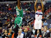 Jan 25, 2016; Washington, DC, USA; Washington Wizards guard Bradley Beal (3) attempts a shot as Boston Celtics forward Amir Johnson (90) defends during the first half at Verizon Center. Mandatory Credit: Brad Mills-USA TODAY Sports