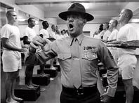 "Actor Lee Ermey, portraying ""Gunnery Sgt. Hartman,"" yells at new Marine recruits in this scene from the 1987 movie ""Full Metal Jacket"" directed by Stanley Kubrick. Kubrick died Sunday, March 7, 1999 at his home in England, his family said. He was 70."