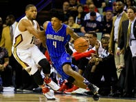 Nov 3, 2015; New Orleans, LA, USA; Orlando Magic guard Elfrid Payton (4) drives past New Orleans Pelicans guard Eric Gordon (10) during the second half of a game at the Smoothie King Center. The Magic defeated the Pelicans 103-94. Mandatory Credit: Derick E. Hingle-USA TODAY Sports