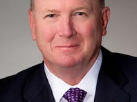 Kenneth Asbury, President and CEO of CACI International.
