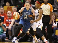 Oct 11, 2015; Indianapolis, IN, USA; Minnesota Lynx guard Lindsay Whalen (13) dribbles the ball as Indiana Fever guard Briann January (20) defends during game four of the WNBA Finals at Bankers Life Fieldhouse. Indiana won 75-69. Mandatory Credit: Brian Spurlock-USA TODAY Sports