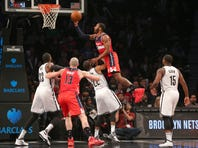 Dec 26, 2015; Brooklyn, NY, USA; Washington Wizards point guard John Wall (2) drives over Brooklyn Nets shooting guard Markel Brown (22) during the fourth quarter at Barclays Center. The Wizards defeated the Nets 111-96. Mandatory Credit: Brad Penner-USA TODAY Sports